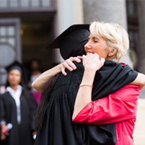 College graduate hugging her mother