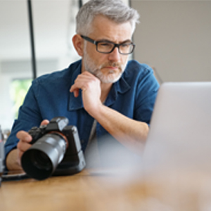 Photographer editing images on computer=